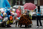 Deborah Knight, center, grandmother of Michelle Knight, drives her wheelchair past the home of Gina DeJesus in Cleveland. Photo / AP