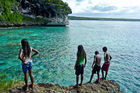 Local children jump from rocks into the ocean on the Island of Lifou in the Loyalty Islands, New Caledonia. Photo / Supplied