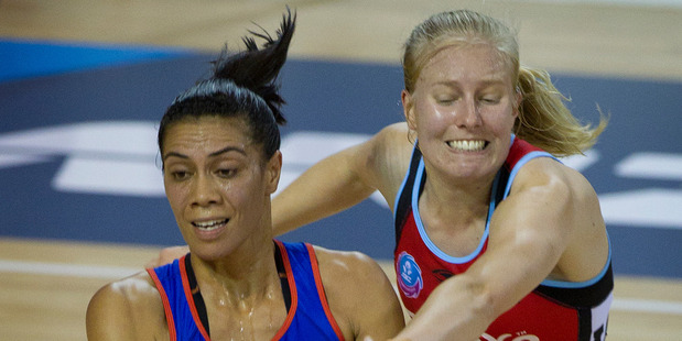 Grace Rasmussen of the Mystics fights to keep the ball from Kirsten Hurley of the Tactix. Photo / Sarah Ivey