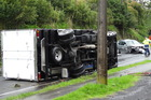 This truck overturned after it and a car collided in Auckland yesterday morning. Photo/ Mark Smith
