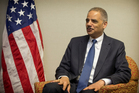 US Attorney General Eric Holder talks with media during his brief visit to New Zealand. Photo / Greg Bowker