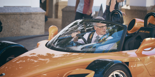 Massey vice-chancellor Steve Maharey in the Hulme Supercar that featured in an advertisement for the university. Photo / Supplied