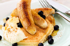 Buttermilk hotcakes with fried bananas and mascarpone. Photo / Babiche Martens
