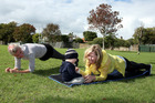 Trainer Simone Rank takes Rachel Grunwell and her baby, Finn Grunwell, (22 months) through exercises during a boot camp session at Rose Park, Belmont. Photo / Getty Images