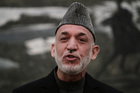 Hamid Karzai declared handouts from the CIA and MI6 are an