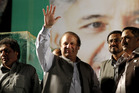 Pakistan's former Prime Minister Nawaz Sharif waves to his supporters during an election rally in Rawalpindi, Pakistan. Photo / AP