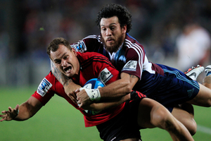 Crusaders Israel Dagg is tackled by the Blues Rene Ranger. Photo / Richard Robinson