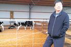 Shanghai Pengxin chairman Jiang Zhaobai at a Waikato dairy farm. Photo / Supplied