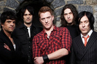 Josh Homme (above centre) with Queens of the Stone Age. Photo / Supplied