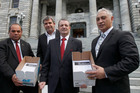 Family First national director Bob McCoskrie, second left, with MPs after presenting the 50,000-signature petition opposing gay marriage. Photo / NZ Herald