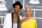 Wiz Khalifa, left, and his fiancee Amber Rose. Photo / AP