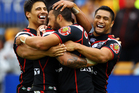Feleti Mateo of the Warriors is mobbed by teammates Ben Henry and Jerome Ropati after his try during the round eight NRL match. Photo / Getty Images.