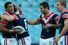Michael Jennings of the Roosters celebrates scoring a try with teammates. Photo / Getty Images