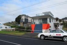 The scene at a Waihi Beach address where Murray Wilkinson was attacked. Photo / Waihi Leader