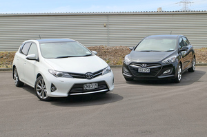 The popular Toyota Corolla (left) rides better, but it costs more than the Hyundai i30 Elite.Pictures/David Linklater Photo / David Linklater