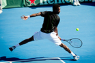 Gael Monfils of France shows his style against Australia's Greg Jones yesterday.  Photo / Dean Purcell