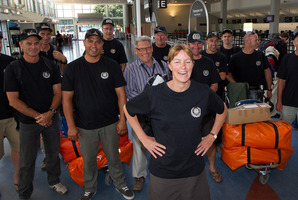 Whangarei Rural Fire and Department of Conservation (DOC) employee Clea Gardiner (C) pictured at Auckland International Airport with her fellow team members before flying out. Photo / Sarah Ivey