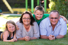 Brent and Kathryn Morgan with Mackenzie and Willie. They survived the Boxing Day tsunami in 2004. Photo / Martin Hunter