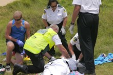 The injured man is tended by Northland Electricity rescue helicopter staff. Photo / C Pinkney