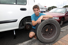 Nick Burridge changes a tyre in Mission Bay Auckland today to demonstrate the lack of basic skills known by the young Kiwi male. 12th January 2013 Herald on Sunday photograph by Doug Sherring