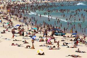 People flock to Bondi Beach to cool off in Sydney, Australia. Record temperatures were reached as high as 43 degrees around Sydney. Photo / Getty Images
