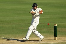 Dean Brownlie smashes a six on his way to his maiden test century. Photo / Getty Images