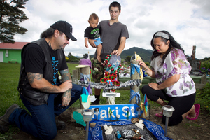 Zharian Watkins' parents John Watkins and Vanessa Patea-Watkins, and his brothers Tyrone, 22, and Tamatoa Watkins, 10 months, visit Zharian's grave.  Photo / Natalie Slade