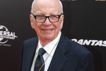 Media magnate Rupert Murdoch, pictured with his wife Wendi, is restructuring his businesses after the hacking scandal. Photo / AP