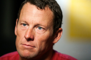 Lance Armstrong is said to be considering admitting to cheating so he can get his athletic career back on track. Photo / AP