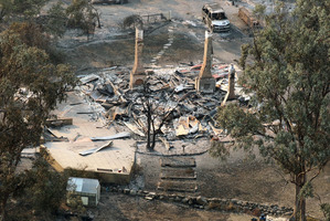 One of the Dunalley properties caught in the blaze east of Hobart. Photo / AP