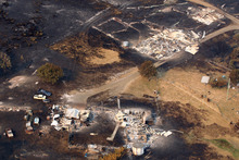 This aerial photo shows homes destroyed by a wildfire between Dunalley and Boomer Bay, east of the Tasmanian capital of Hobart, Australia. Photo / AP