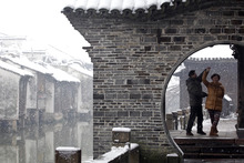A couple dance in the snow in Tongxiang in Zhejiang province. A government clampdown on dissenting views leaves little hope for a Chinese people-power renaissance. Photo / AP