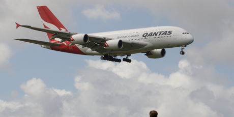 Qantas' Airbus A380, watched by spectators at the Puhinui lookout, comes in to land at Auckland Airport after a scenic flight around the upper North Island. Photo / Paul Estcourt