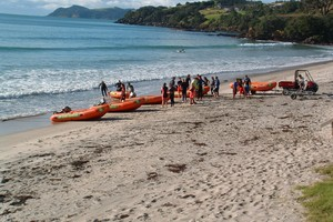 Lifeguards get ready to launch the IRBs Waipu Cove Surf Lifesaving Club training session. Photo / Northern Advocate