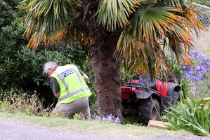 A quad bike left the road and came to rest down a ditch into a fence.  Photo / APN