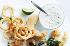 Beer-battered prawns and onion rings with lime tartare sauce. Photo / Donna Hay Magazine