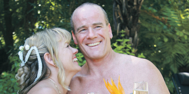 Wendy and Nick Lowe pictured during their wedding at the weekend where the naturist bride and groom, and many of the guests, attended the ceremony naked.