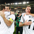 Nelsen hugs Tim Brown and Shane Smeltz hugs Leo Bertos after their win 1-0 over Bahrain. Photo / Mark Mitchell