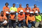 Kiwi contractors Wayne Faapito, Blake Kefu, Andrew Manu, Armine Kay, Ralph Williams, Tee Kefu, Mafi Kefu, Matthew Hapeta and Rob Leilua. They are pictured with fellow worker Ardelius Mitchell.