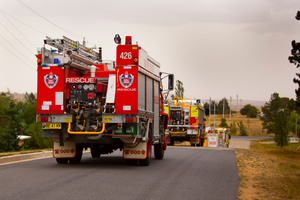 Firetrucks rush towards the Kybeyan Valley, New South Wales. Photo / Getty