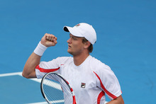 Greg Jones of Australia celebrates his first round match win against Jurgen Melzer of Austria during day two of the Heineken Open. Photo / Getty Images