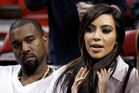 Kim Kardashian and Kanye West at a Miami Heat game. Photo/AP