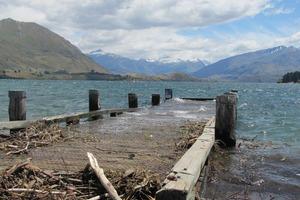 The Lake Wanaka wharf disappears beneath the waves. Photo / Mark Price