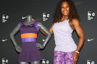 Serena Williams poses with her outfit which she will debut at the 2013 Australian Open. Photo / Getty Images