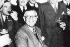 Sir Archibald McIndoe and his 'boys' singing at the Guinea Pig Club reunion in 1948. Photo / Supplied