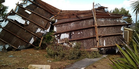 A shed blown up against Mr Ray Kealls home on Beach Road Kaikoura. Photo / Gerald Day