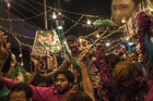 Supporters of Pakistan Muslim League-N (PMLN) celebrate election results in Lahore, Pakistan. Photo / Getty