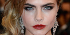 Model Cara Delevingne walked the Cannes red carpet in Chopard gems.Photo / AFP
