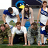 Britain's Prince Harry kneels at the bottom of a pyramid of cheerleaders, US and British military officials at the academy in Colorado Springs, Colorado. Photo / AP