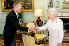 Britain's Queen Elizabeth II greets the High Commissioner for New Zealand, Dr The Right Honourable Alexander Lockwood Smith, at an audience at Buckingham Palace, in central London. Photo / AP
